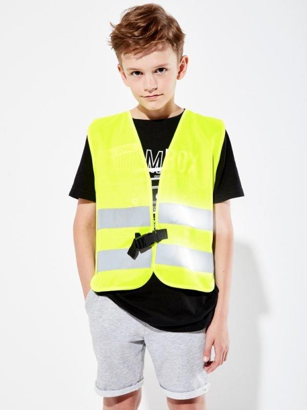 żółta kamizelka odblaskowa dla dzieci z klipem UU204 - sesja zdjęciowa